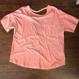 Bright peach/orange top with back cutout